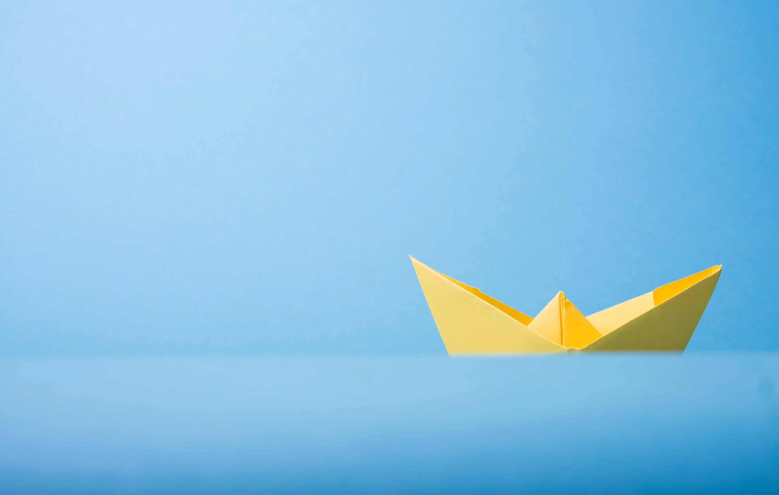 Closeup Photo of Yellow Paper Boat Photo