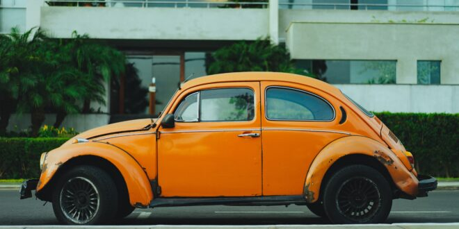shallow focus photography of orange Volkswagen Beetle photo